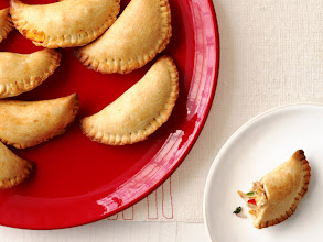 Photo: Chicken Mini Empanadas: Sandra's kid-size empanadas are easy to make with packaged pie dough mix. Young chefs can help shape the little half-moons — they don't have to be perfect! Get this recipe >> http://ow.ly/bsjnD