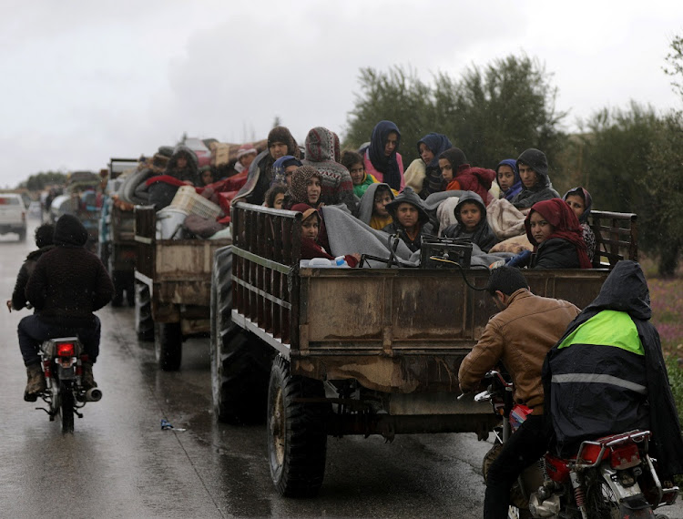 People flee in the northeast of Afrin, Syria, March 15 2018. Picture: REUTERS