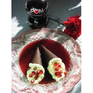 Bittersweet Chocolate Cones Filled With White Chocolate Mousse, Floating On Pomegranate Sauce