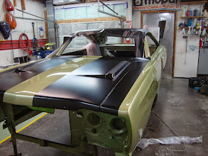 Photo: This is the correct sizing and placement of the hood black out but not the correct finish. This is 30 degree semi gloss black. We are waiting for the correct Organisol Paint then we will redo the hood and fenders.