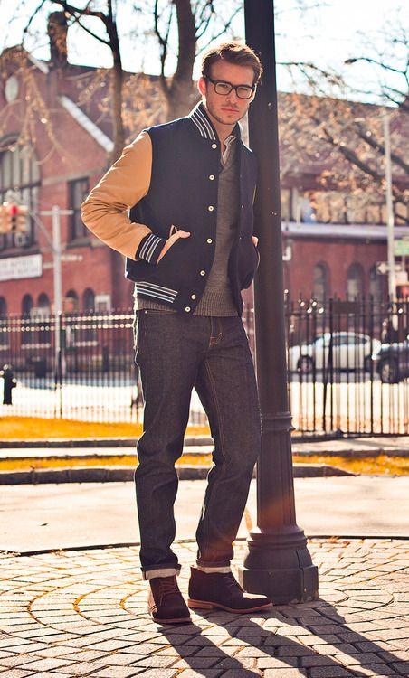 varsity jacket on top of a grey jeans