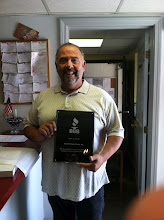 Photo: Patrick Cibotti of Boston Body Works in Roxbury, MA celebrating 25 years as an Accredited Business