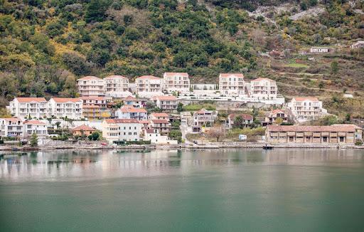 Kotor-shoreline.jpg - Buildings line the pretty shoreline of Kotor, Montenegro,