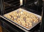 3. Remove baking sheet from oven and drizzle with 2 tablespoons oil. Transfer potatoes...