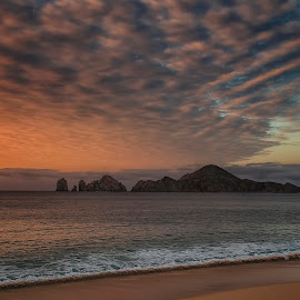 Sunrise At Lands End by Scott Hryciuk - Landscapes Sunsets & Sunrises ( sunrise, mexico, cabo san lucas, rocks, ocean, rock formations, cabo, daybreak, clouds, water )