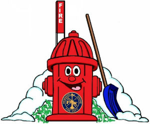 A red charactured fire hydrant with snow and snow shovel.
