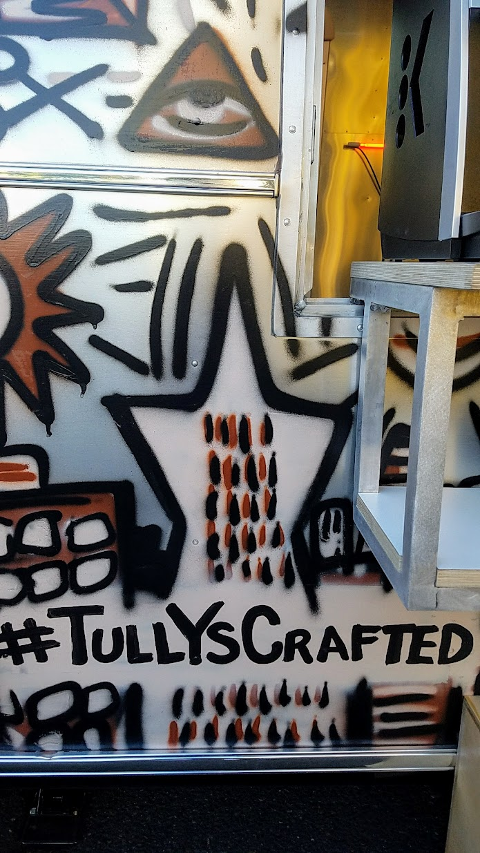 This Tully's Trailer is on a special #TullysCrafted tour from San Francisco to Seattle, where it stops at various local cities where a local artist contributes their artistic skills to help decorate the trailer. After getting an outside paint job and neon art inside from 2 visual artists in San Francisco, here in Portland another local artist is scheduled to add more interior decor touches before it continues on to Seattle.