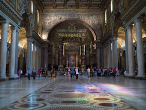 Photo: The main Nave of Santa Maria Maggiore illuminated by light from the rose window in the facade