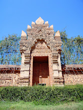 """Photo: Lamphun Gateway +DoorSunday #DoorSunday Curated by +André Roßbach +Dave Krugman:- Pretty impressive huh! This awesome looking door and gate is a section of an ornamental wall that forms part of the """"Queen Chamadevi Monument"""" in the town of Lamphun in the north of Thailand.Queen Chamadevi founded Lamphun as the capital of the Haripunchai kingdom in the 9th century.Not far from the town's main market there is a statue of the Queen (offerings are still left to this very day), this ornate and beautiful stone doorway sits behind that statue.There are many legends about the Lanna Queen """"Chamadevi"""". Apparently she was a strikingly beautiful woman who endured many personal misfortunes. More information about the Queen can be found here :-http://hilltribethailand.blogspot.co.uk/2009/01/legend-s-of-queen-chamadevi.html  Photography by Justin Hill ©"""