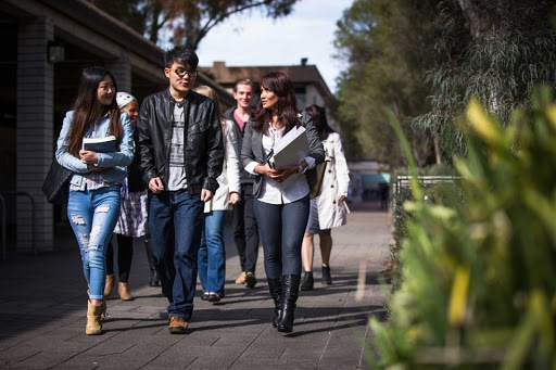 Canberra universities press for more urgent action to return international students to campuses