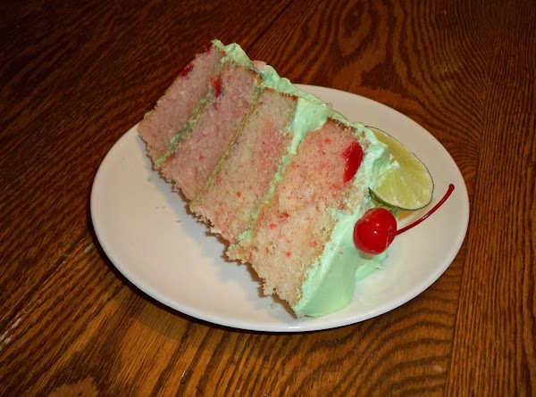 Decorate the top of the cake with lime wedges, cherries with stems and straws...