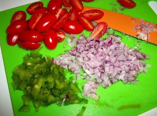 Place pepper, onion, tomatoes in a bowl, then add the cooled corn.