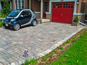Photo: Even in Oakville clay, permeable stone helps water infiltrate. it looks stunning and will last hundreds of years. Limestone cobbles act as a soldier row, holding it all together.