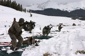 Photo: Soldiers from A Co., 3rd Battalion, 10th Special Forces Group (Airborne), conduct weather exposure training here, Jan. 22. The Green Berets from Fort Carson are conducting five days of tactical training and cold weather survival. (Photo by Staff Sgt. Michael R. Noggle)