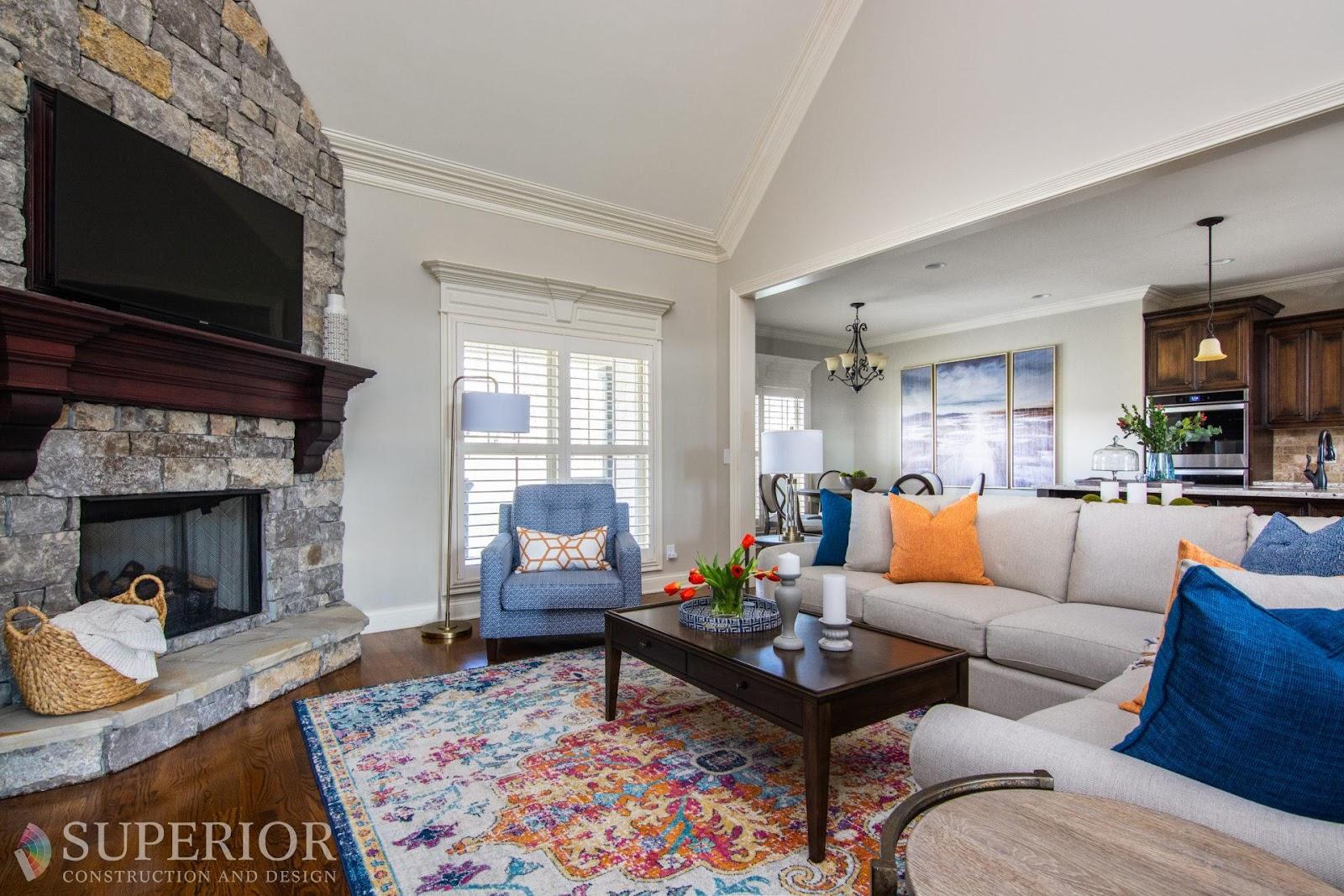 decorated living room tn orange blue cream furnishings sofa chairs pillows decor budget