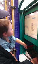 Photo: The Boy started to noticed that the machine was showing him his money amounts and counting so he checked in to see how much was in there.