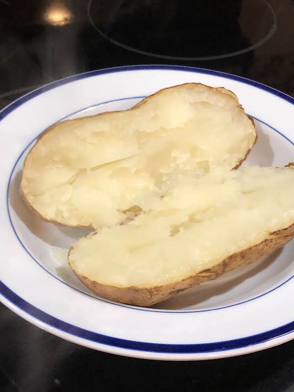 Steaming Hot Baked Potato Fresh Out Of The Oven. No Foil Needed