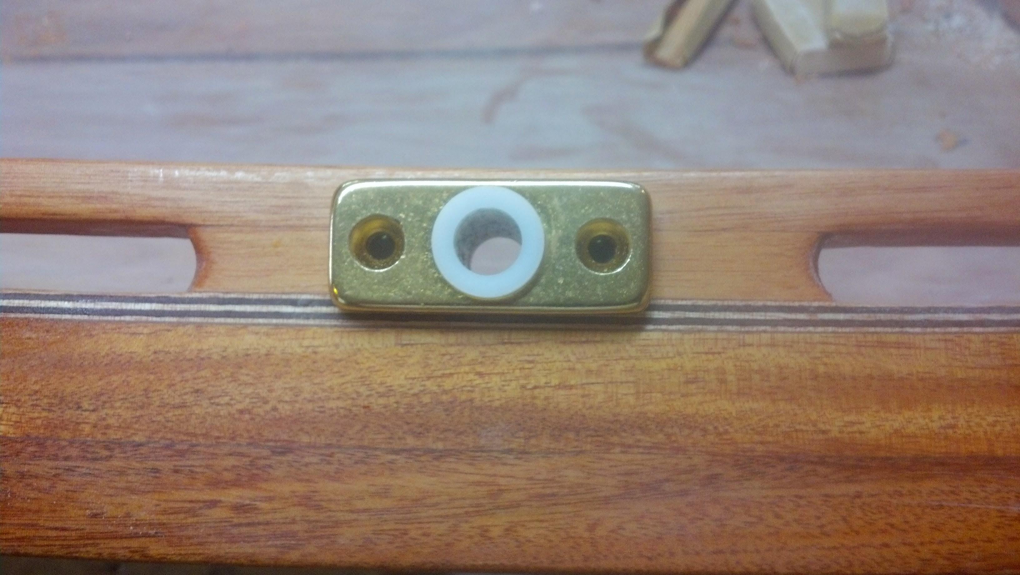 """Photo: Oar lock socket in newly drilled 13/16"""" hole in inner rail"""