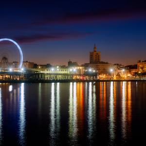 View of Malaga city and Ferris wheel from harbour, Malaga, Spain.jpg