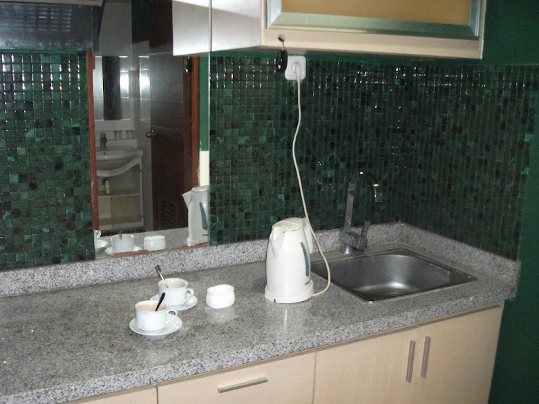 Sink and kitchen set in our Superior Room