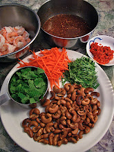 Photo: fried cashews, cooked shrimp and hot-and-sour dressing added to salad ingredients
