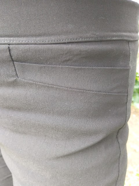 An overexposed close up of the pockets in the pants. They are horizontal, angling upwards towards the waistband.