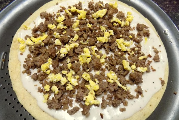 On each pizza, layer with the sausage gravy, crumbled sausage and scrambled egg.
