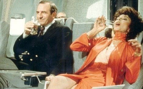Joan Collins on a plane in the Campari advert