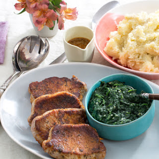 Seared Pork Chops with Two-Cheese Mashed Potatoes & Sautéed Spinach.