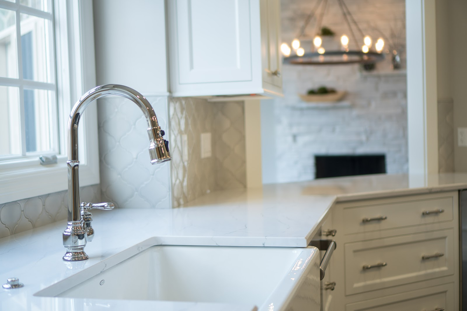 Matthewson Kitchen Sink with Chrome Faucet and White Counter Top