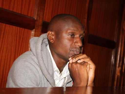 Journalist Moses Dola at the Milimani law courts during the ruling of a case in which he is accused of killing his wife, NTV journalist Wambui Kabiru.