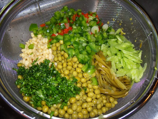 Drain the shoe peg corn, canned baby peas and french-cut green beans. Combine in...