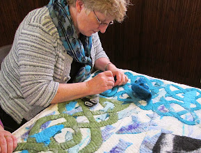 Photo: adding lines of needlefelting around hte edges of the cut-outs creates the Celtic knotwork look