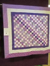 """Photo: Christine Cooper, Mavis Gaines, Jeanette Hooper, Norma Kindseth""""Fifty Shades of Purple With a Touch of Gray""""TEAM CHALLENGE QUILT"""