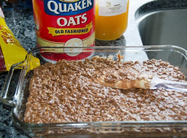 Pour melted peanut butter mixture over the dry ingredients in the bowl. Mix well...