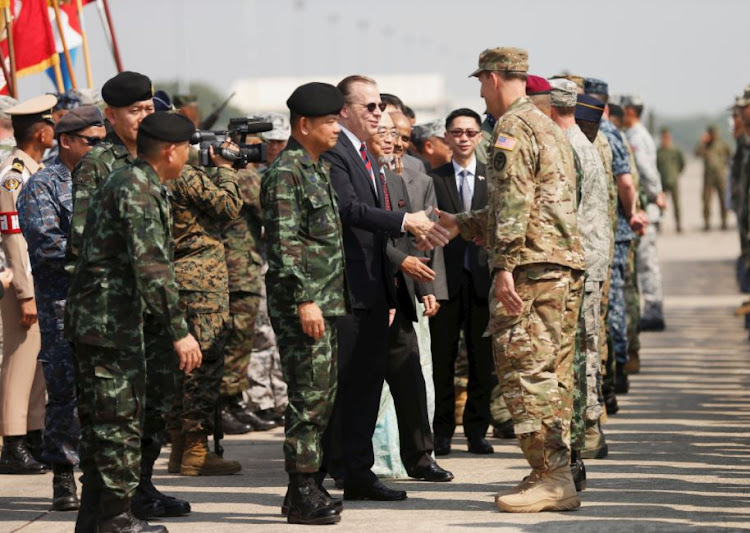 Ambassador Glyn T. Davies (C) shakes hand with soldiers during opening ceremony of Cobra Gold, Asia's largest annual multilateral military exercise, outside Bangkok, Thailand February 13, 2018.