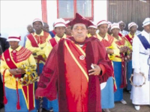 BLESS YOU: Archbishop Peter Moloi leads congregants at the St Paul Apostolic Faith Mission in Evaton yesterday. Pic. Penwell Dlamini. 03/08/08. © Sowetan.
