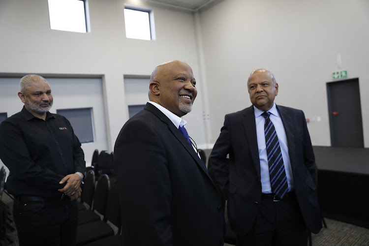 Former deputy finance minister Mcebisi Jonas with Minister Pravin Gordhan at the Zondo commission of inquiry into state capture in Parktown, Johannesburg on August 24 2018.