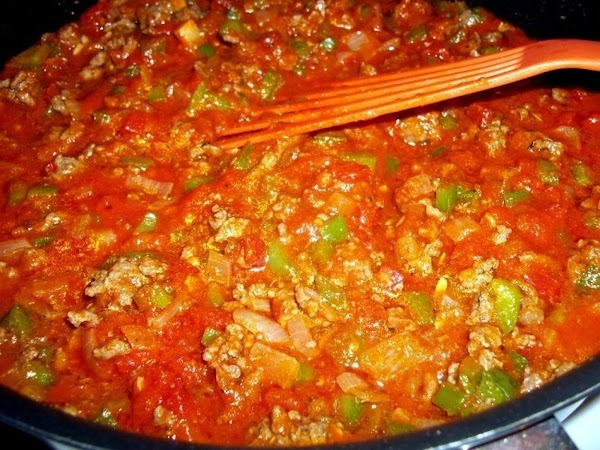 Return meat and veggies back to pan, add tomatoes and sauce, simmer for a...
