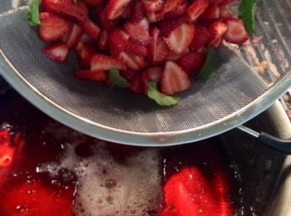 Add reserved fruit, mint, black pepper and butter to the syrup. Continue to boil,...