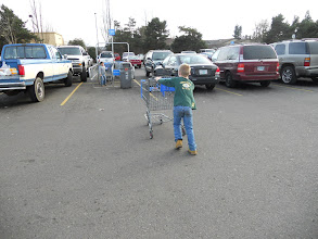 Photo: My youngest loves to put the cart away, he is getting so big..