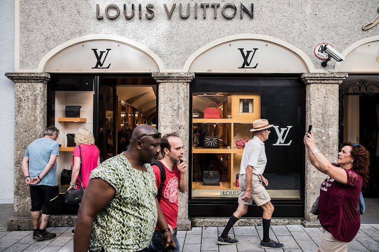 Pedestrians walk by a LVMH luxury store store in Salzburg, Austria, September 12 2018.Chinese consumers make up the lion's share of growth for the luxury businesses. Picture: BLOOMBERG/AKOS STILLER