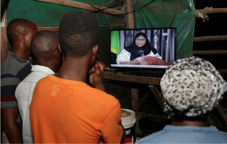 Residents watch the television announcement of the death of Tanzania's President John Magufuli, addressed by Vice President Samia Suluhu Hassan in Dar es Salaam, Tanzania on March 18 2021.