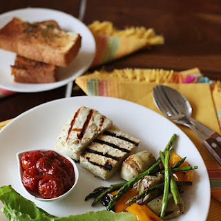 Grilled Paneer Cheese With Roasted Artichoke, Asparagus & Bell pepper Salad & Cherry Tomato Fondue.