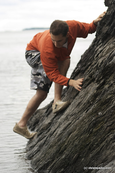 Photo: Climbing the rocks at Knight Island State Park