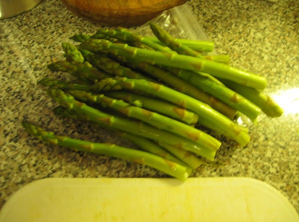 Wash and snap the asparagus.  To snap the asparagus, hold at the bottom...