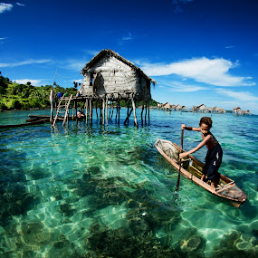 Row row row your boat.... by Siew Jun Han - People Street & Candids ( child, native, semporna, sea, malaysia, ocean, boat, sabah, kid )
