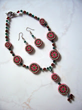 "Photo: PCF- 104 Necklace and earrings set. Polymer Clay red pearl poinsettia cane beads, crystal and glass beads. 17.5"", $109.00"