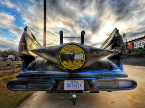 Photo: The Batmobile  Everyone likes the Batmobile yes?  It's especially cool when you see one on the side of the road in Texas that some comic-book redneck has souped up to be something that is on the edge of street-legal.  I jumped out quick to grab a shot before the owner could come out and hit me with some sort of a 2x4, which I only assumed me might be carrying.  Actually, you never know... around Austin it's just as likely to be a doctor or lawyer (assuming one of those two to be an honorable, upstanding profession!  (also notice the nice only-in-Texas trailer hitch on the back)  from the blog at www.stuckincustoms.com