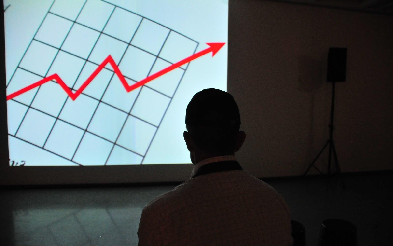 man looking at a chart